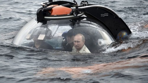 Russian President Vladimir Putin looks through a window of a research bathyscaphe while submerging into the waters of the Black Sea near Sevastopol