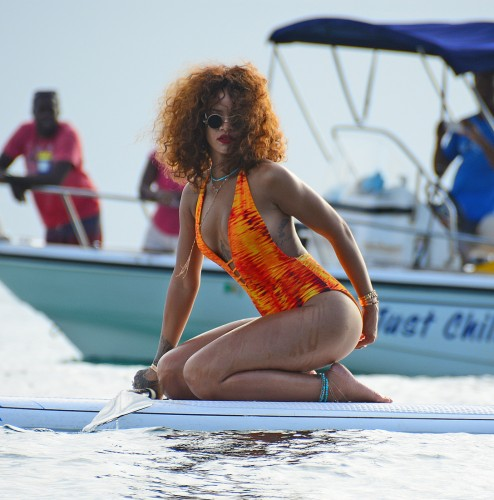 EXCLUSIVE: **PREMIUM RATES APPLY**NO WEB UNTIL 5PM GMT AUG 7 2015**STRICTLY NO SUBSCRIPTIONS**Rihanna is spotted paddle boarding while on holiday in her home town Barbados on Aug 5th 2015