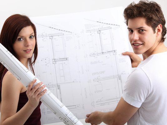 young couple with construction plans