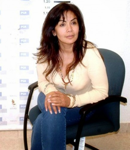 Queen of the Pacific, a Mexican drug cartel leader Sandra Avila Beltran in cuffs & jeans