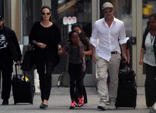 Angelina Jolie and Brad Pitt with children Maddox and Zahara at LAX