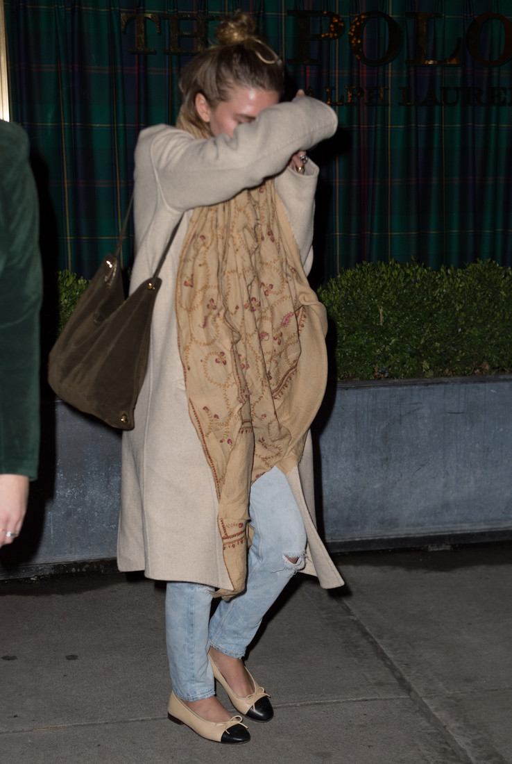 Ashley Olsen hides her face after being asked about dating David Schulte again in NYC.