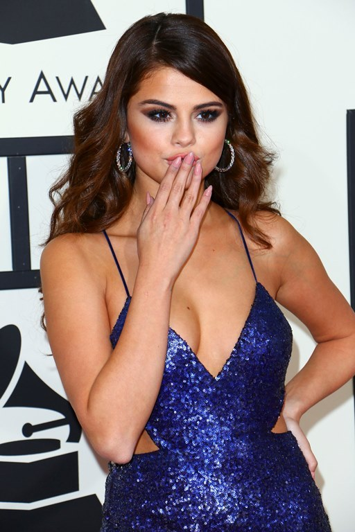Taylor Swift and Selena Gomez at the 58th Annual GRAMMY Awards Red Carpet held at the Staples Center in Los Angeles, CA. Pictured: Selena Gomez Ref: SPL1228730  150216   Picture by: ITM / Splash News Splash News and Pictures Los Angeles:310-821-2666 New York:212-619-2666 London:870-934-2666 photodesk@splashnews.com
