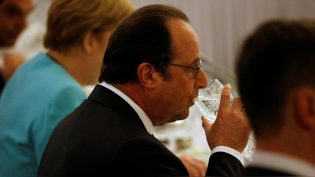 Hollande takes part in a NATO Summit working dinner at the Presidential Palace in Warsaw, Poland